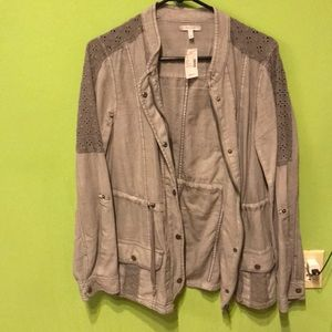 Gray utility jacket with embroidered shoulders.